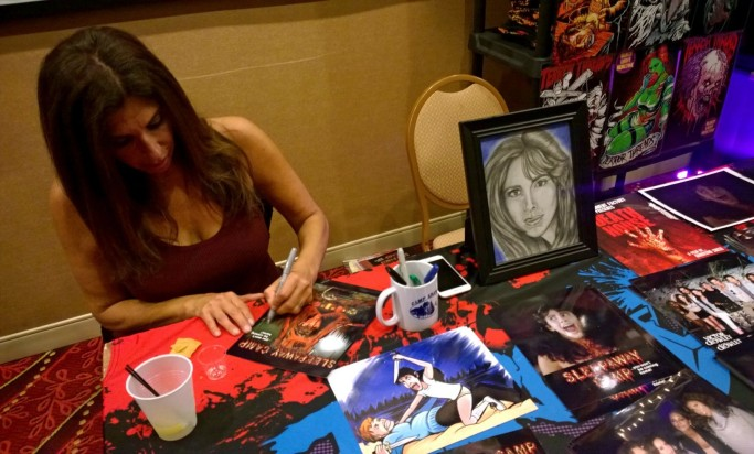Actress Felissa Rose displays Living Dead Girl NIcole's Happy Camper art piece on her table at Days Of The Dead Chicago